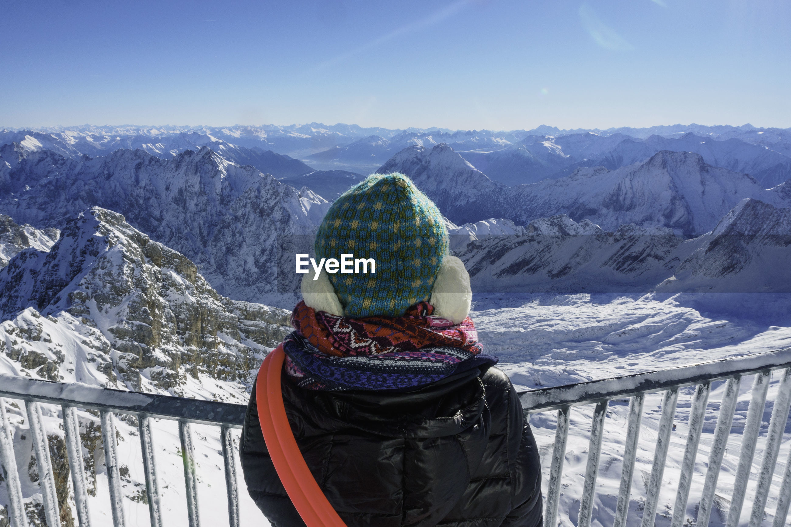 Person looking at snow covered rocky landscape