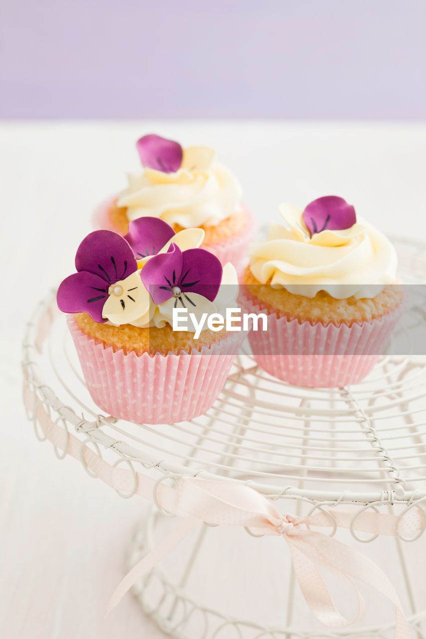 sweet food, cake, dessert, cupcake, sweet, indulgence, food and drink, temptation, food, baked, freshness, indoors, ready-to-eat, table, still life, unhealthy eating, focus on foreground, no people, pink color, close-up, cupcake holder, icing