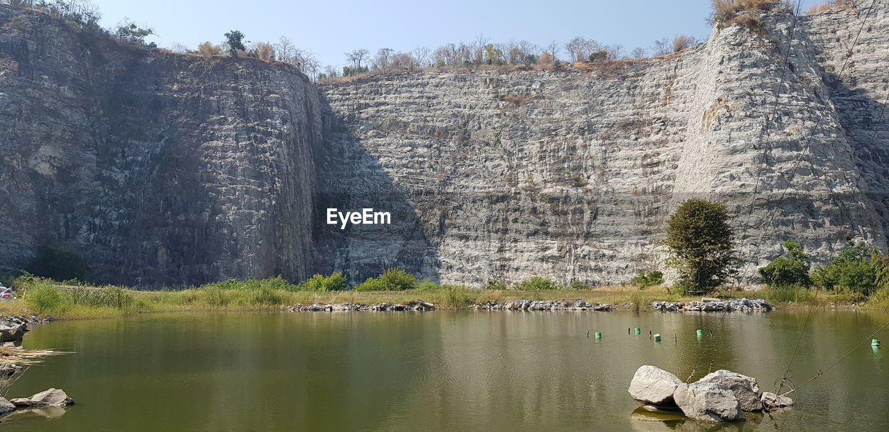SCENIC VIEW OF LAKE AND ROCK FORMATION