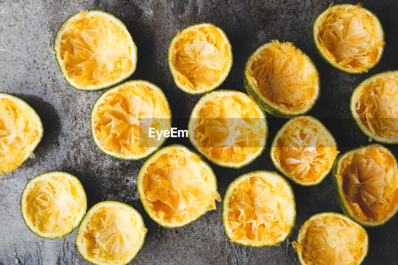 Directly above shot of orange fruits with peel on marble