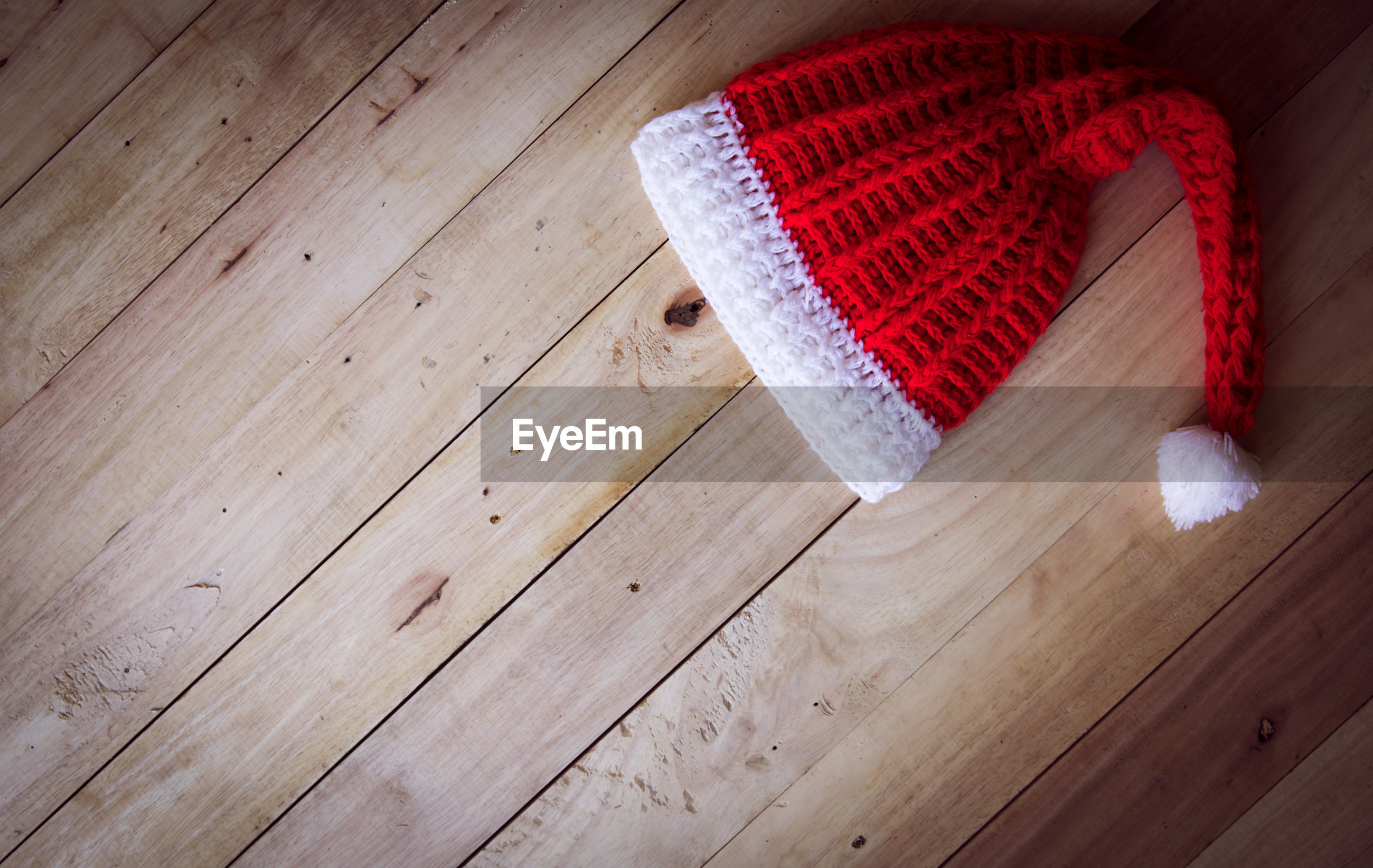 High angle view of knit hat on hardwood floor at home