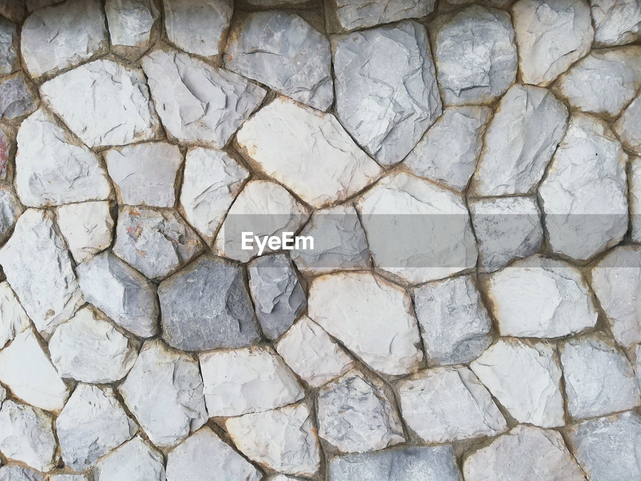backgrounds, full frame, no people, pattern, solid, textured, stone material, close-up, stone wall, day, rough, nature, outdoors, gray, directly above, stone, stone - object, high angle view, wall, architecture, tiled floor, concrete
