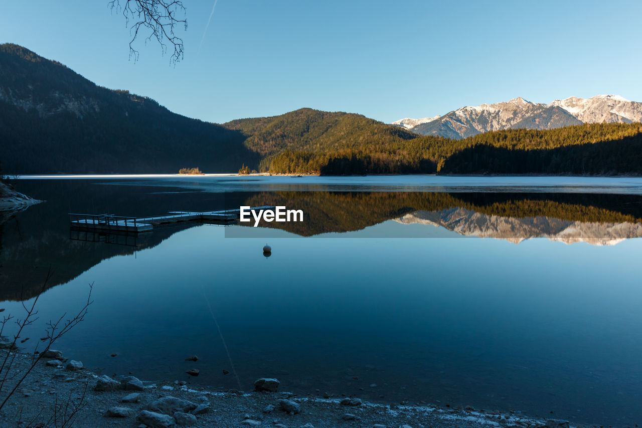 water, mountain, beauty in nature, scenics - nature, tranquil scene, tranquility, lake, reflection, mountain range, sky, nature, non-urban scene, idyllic, waterfront, blue, no people, day, outdoors, remote