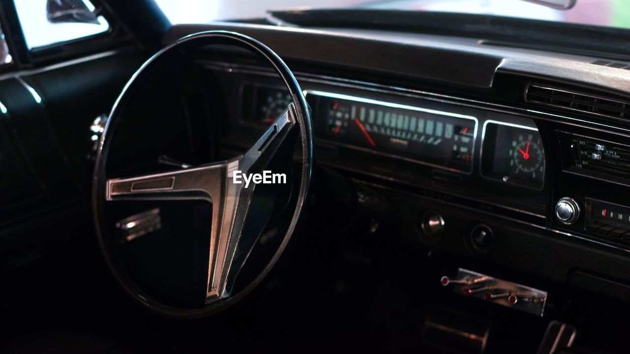 car, mode of transportation, motor vehicle, transportation, land vehicle, car interior, dashboard, retro styled, steering wheel, control panel, no people, vintage car, windshield, vehicle interior, indoors, reflection, glass - material, wealth, focus on foreground, luxury