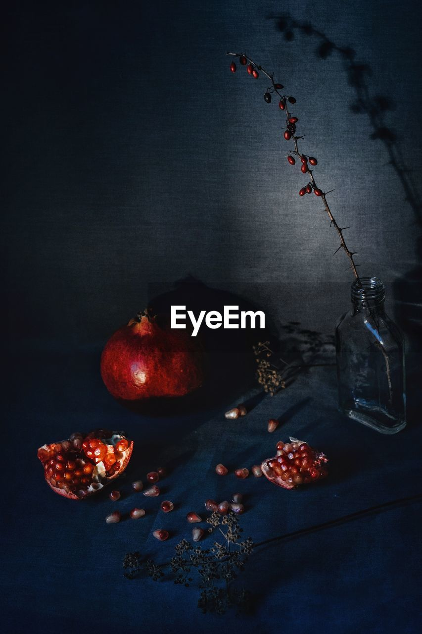 HIGH ANGLE VIEW OF FRUITS ON TABLE AT NIGHT