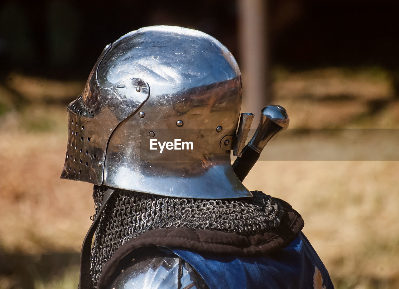 Close-up of person wearing suit of armor