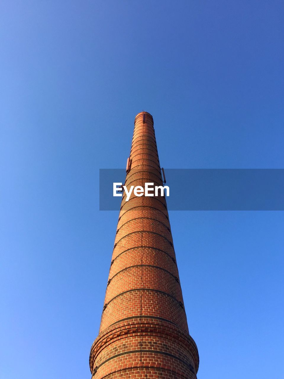 built structure, architecture, blue, low angle view, day, smoke stack, clear sky, no people, building exterior, outdoors, industry, sky