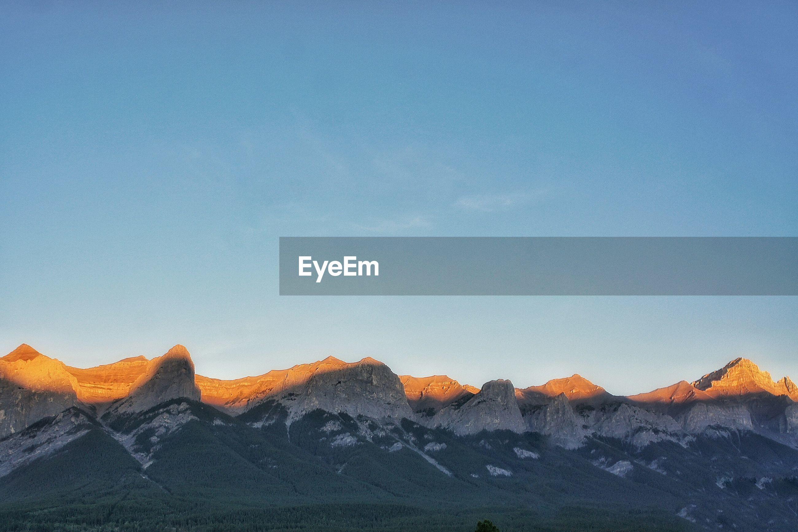 MOUNTAIN AGAINST CLEAR BLUE SKY