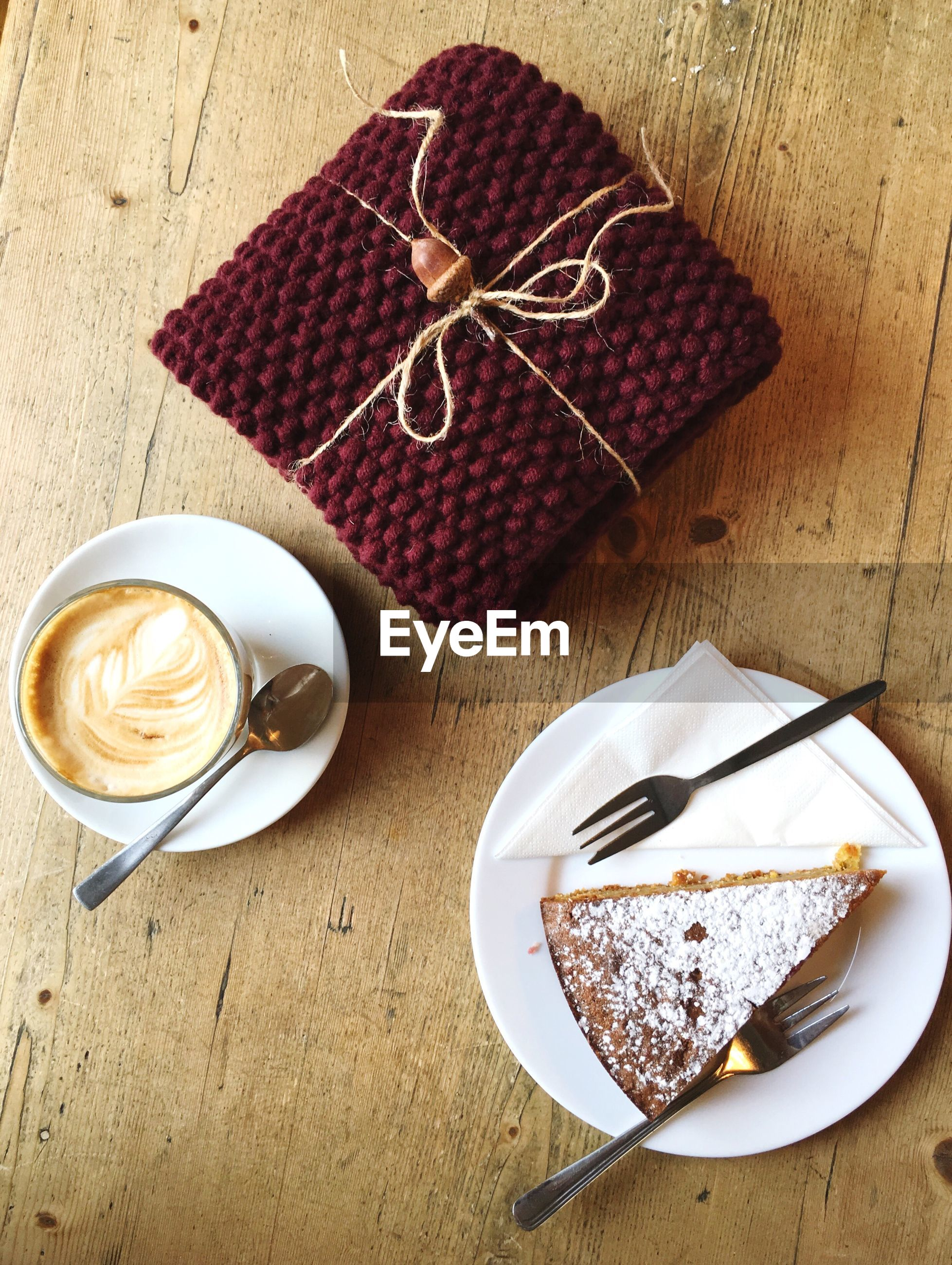 High angle view of cake and coffee with gift on table