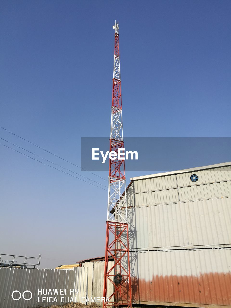 sky, architecture, built structure, low angle view, clear sky, nature, blue, building exterior, metal, industry, no people, day, tall - high, copy space, outdoors, building, machinery, technology, sunlight, tower