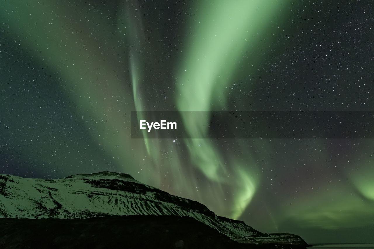 Low Angle View Of Aurora Borealis At Night