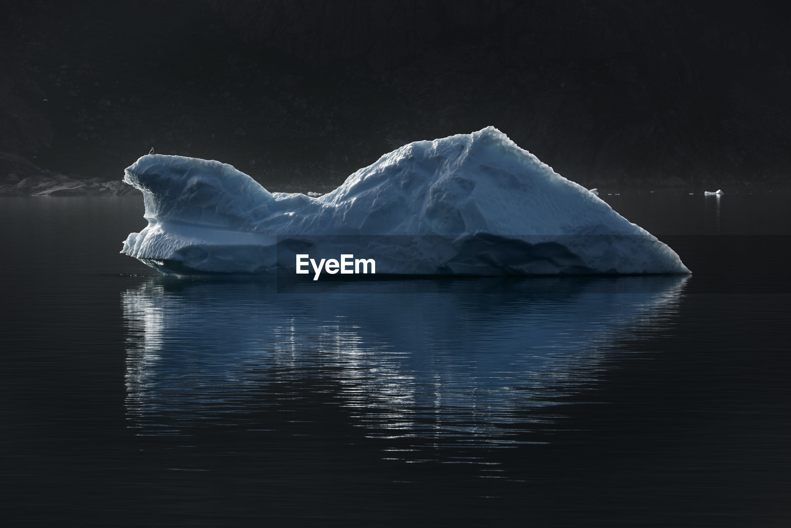 View of glacier in lake against sky at night