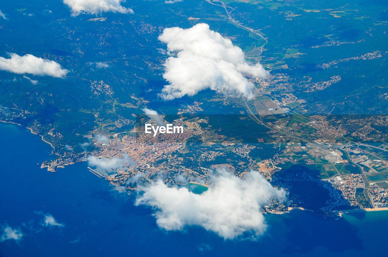Aerial view of barcelona seen from airplane above the clouds