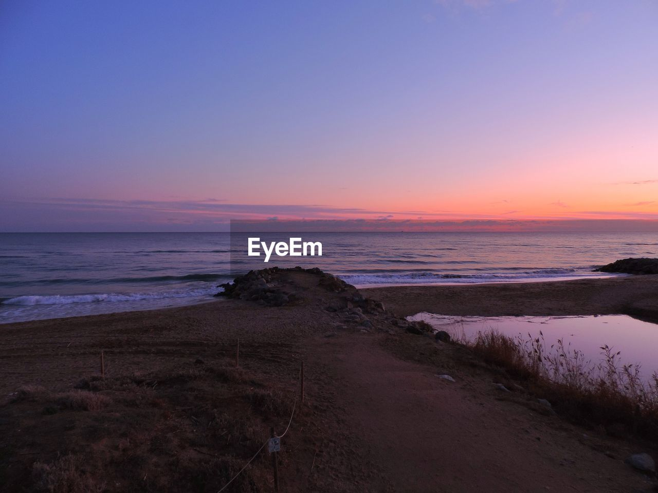 sky, sunset, scenics - nature, water, sea, beauty in nature, beach, tranquility, tranquil scene, horizon over water, horizon, land, orange color, idyllic, no people, nature, non-urban scene, cloud - sky, outdoors