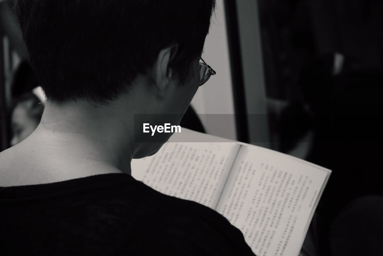 real people, book, one person, indoors, writing, holding, headshot, paper, boys, education, men, human hand, learning, close-up, student, day, people, adult