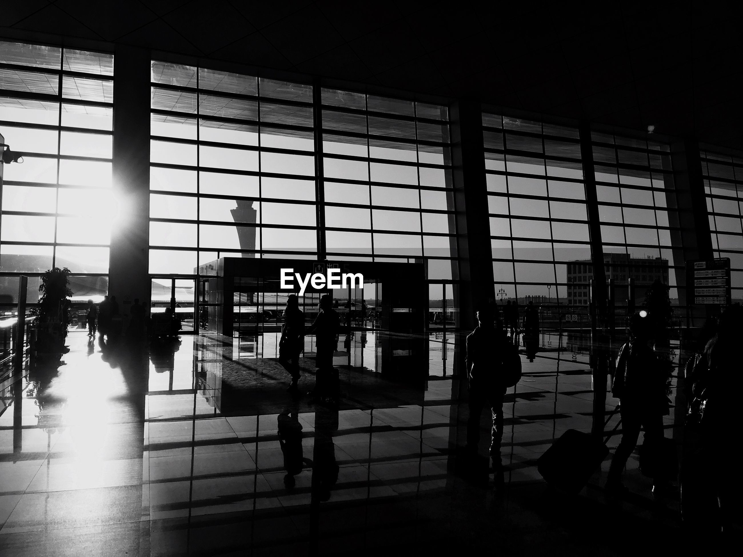 indoors, window, glass - material, built structure, architecture, airport, chair, transparent, men, silhouette, person, modern, table, city, flooring, reflection, lifestyles, restaurant, sunlight