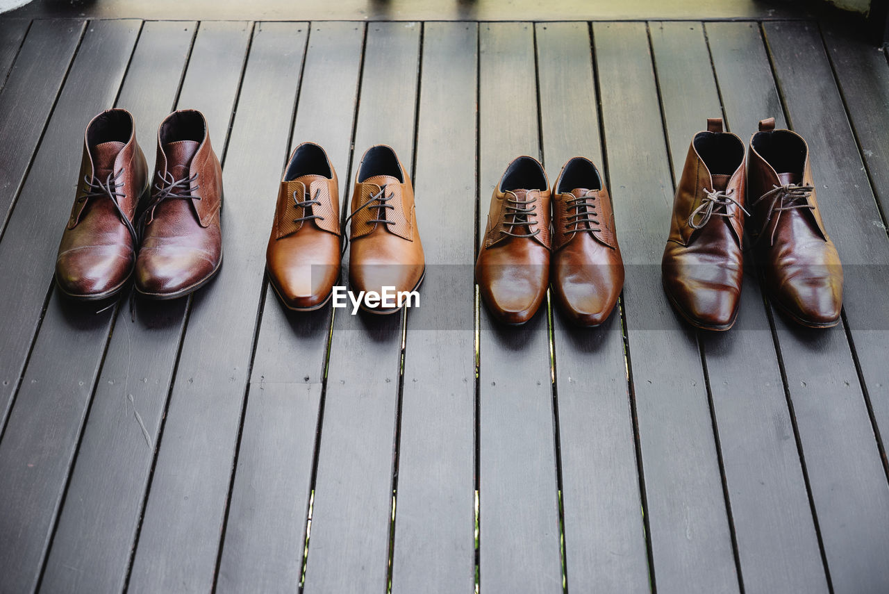 High angle view of leather shoes on table