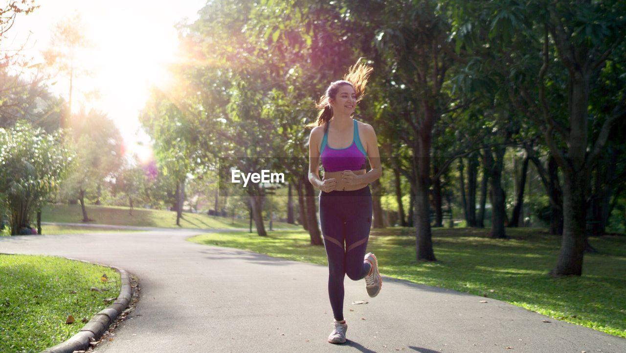 Woman jogging at public park