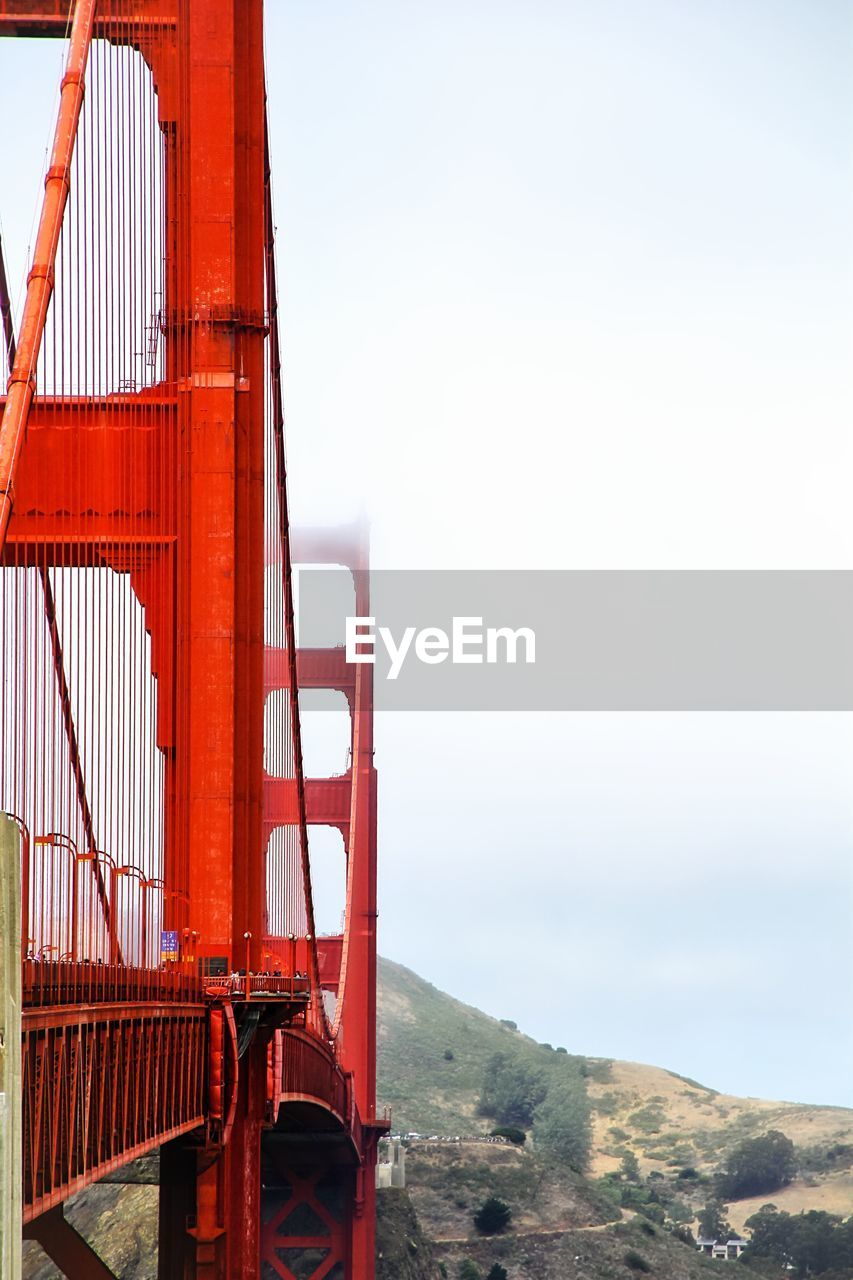 Golden gate bridge against sky during foggy weather