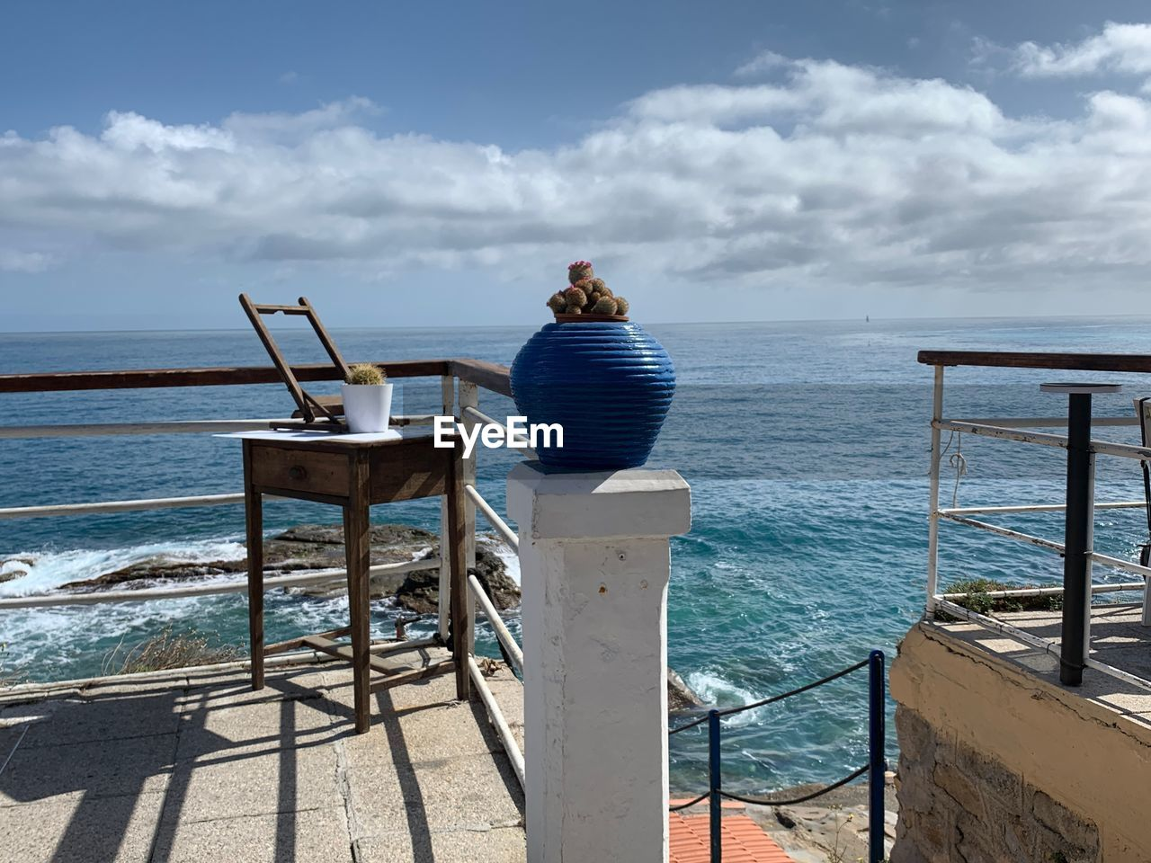 sea, sky, water, cloud - sky, beach, horizon, scenics - nature, horizon over water, nature, beauty in nature, land, seat, tranquil scene, railing, chair, tranquility, day, sunlight, outdoors