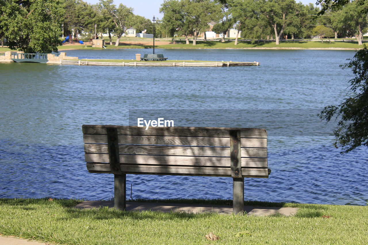 plant, water, grass, tree, nature, seat, bench, day, park, outdoors, empty, lake, no people, tranquility, beauty in nature, scenics - nature, shadow, park bench