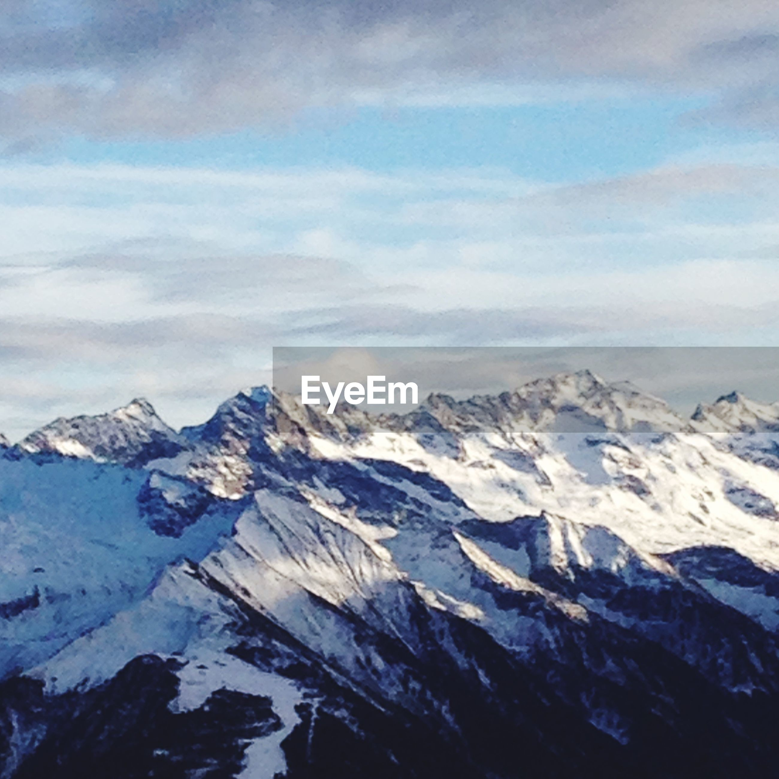MAJESTIC SNOWCAPPED MOUNTAINS AGAINST SKY