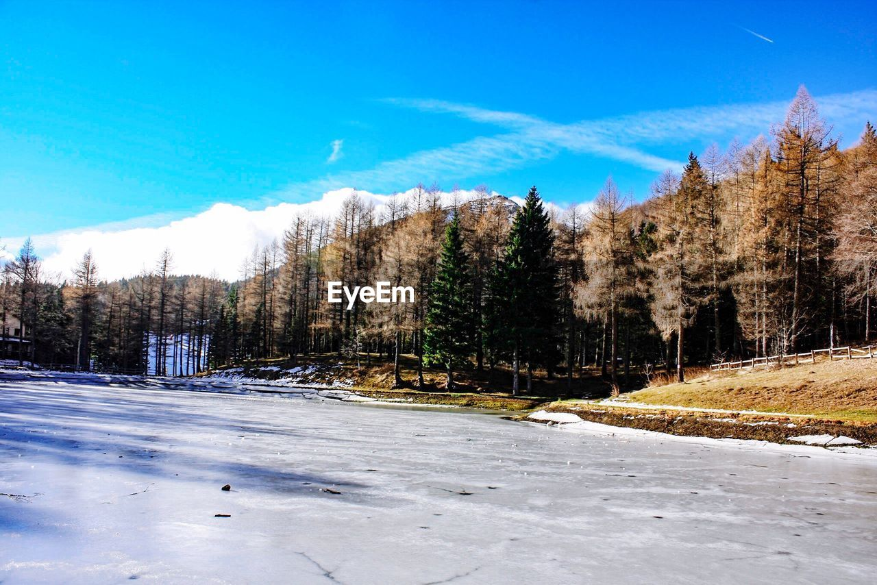 Idyllic view of frozen lake against sky