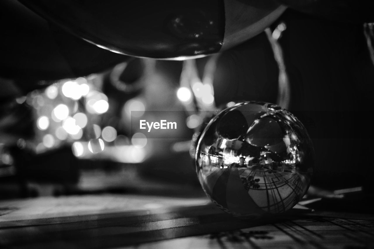 indoors, table, illuminated, reflection, close-up, no people, night, christmas decoration, planet earth