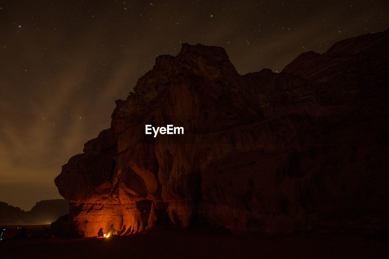 night, rock formation, beauty in nature, star - space, rock, scenics - nature, sky, rock - object, astronomy, space, nature, tranquil scene, solid, geology, tranquility, mountain, physical geography, non-urban scene, no people, galaxy, formation, eroded