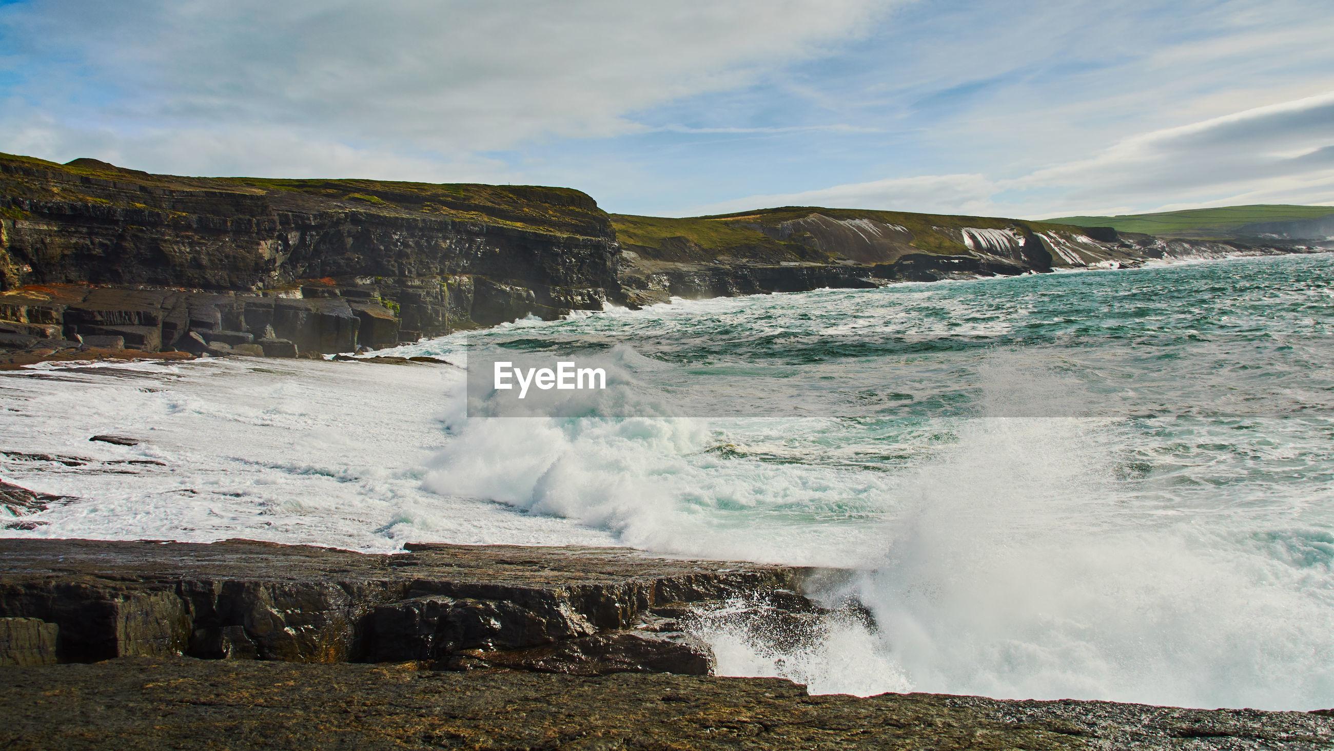 SCENIC VIEW OF WAVES SPLASHING ON SHORE