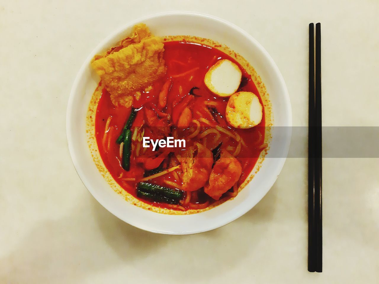 food, healthy eating, ready-to-eat, food and drink, wellbeing, freshness, bowl, indoors, still life, serving size, table, no people, vegetable, close-up, high angle view, directly above, soup, red, asian food, chopsticks, temptation, garnish, korean food