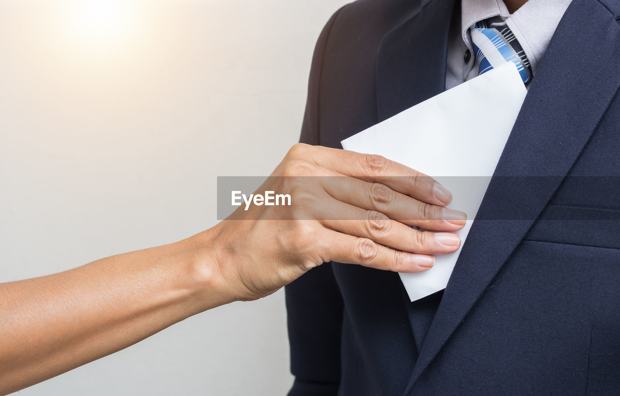 Cropped image of woman bribing businessman