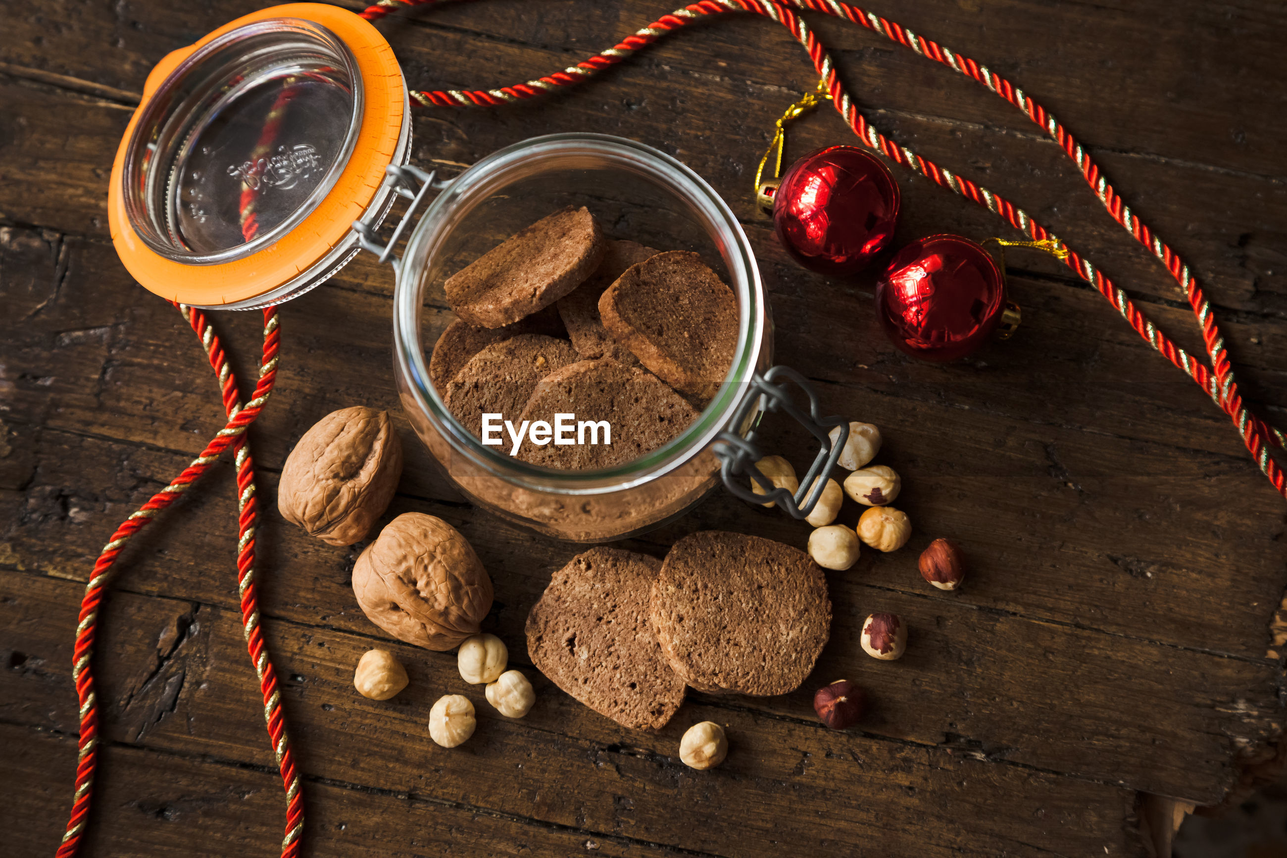 Directly above hot of cookies and walnuts by jar on table