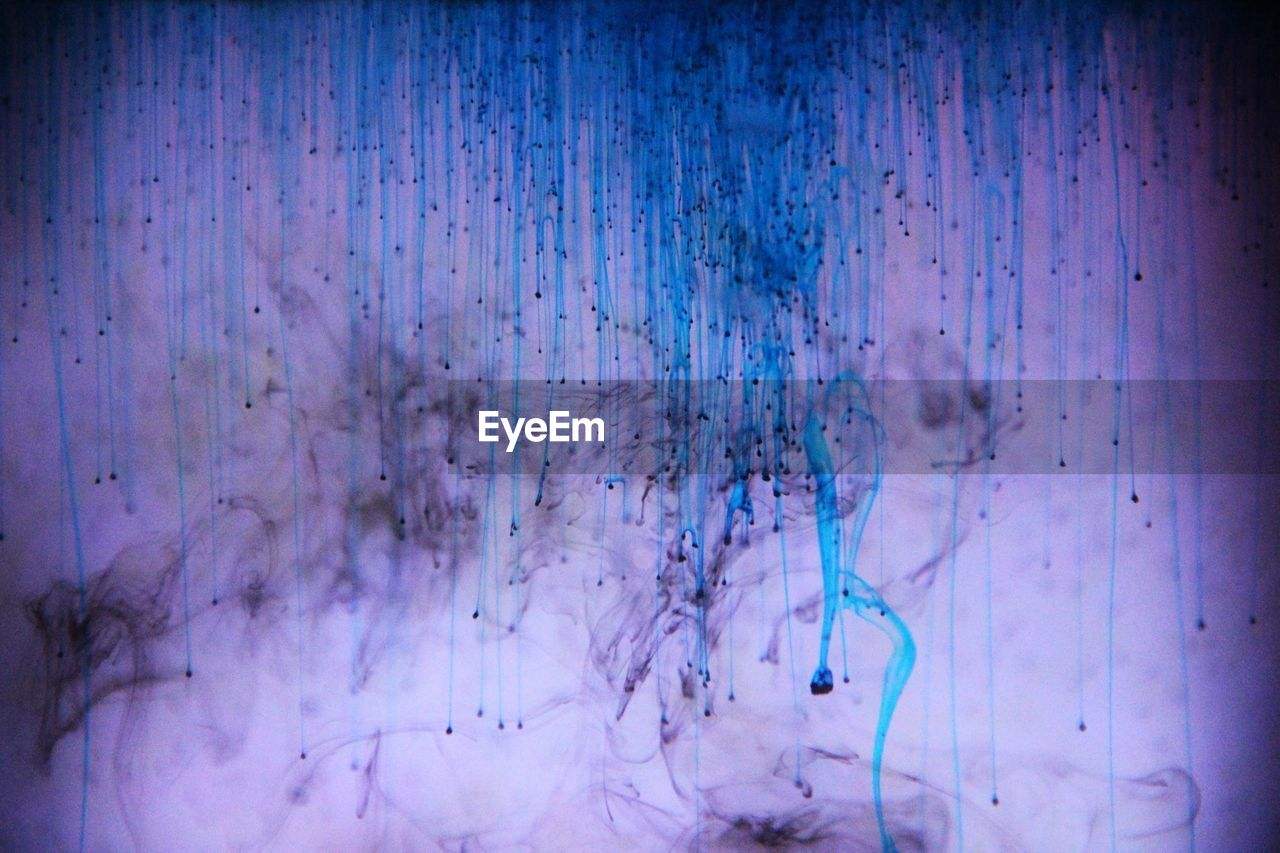 Full Frame Shot Of Blue Ink Mixing With Water