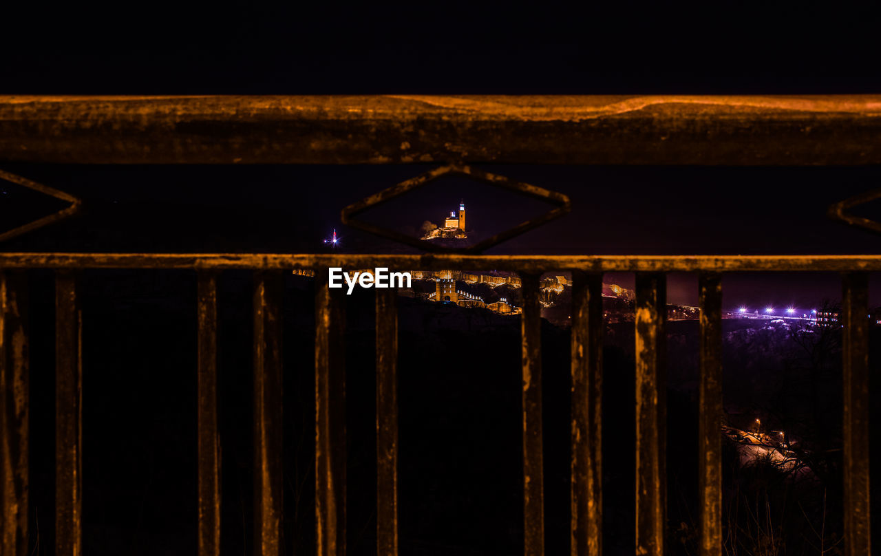 night, illuminated, no people, lighting equipment, light - natural phenomenon, built structure, architecture, dark, nature, sky, low angle view, outdoors, glowing, metal, light, close-up, safety, security, wood - material, stage