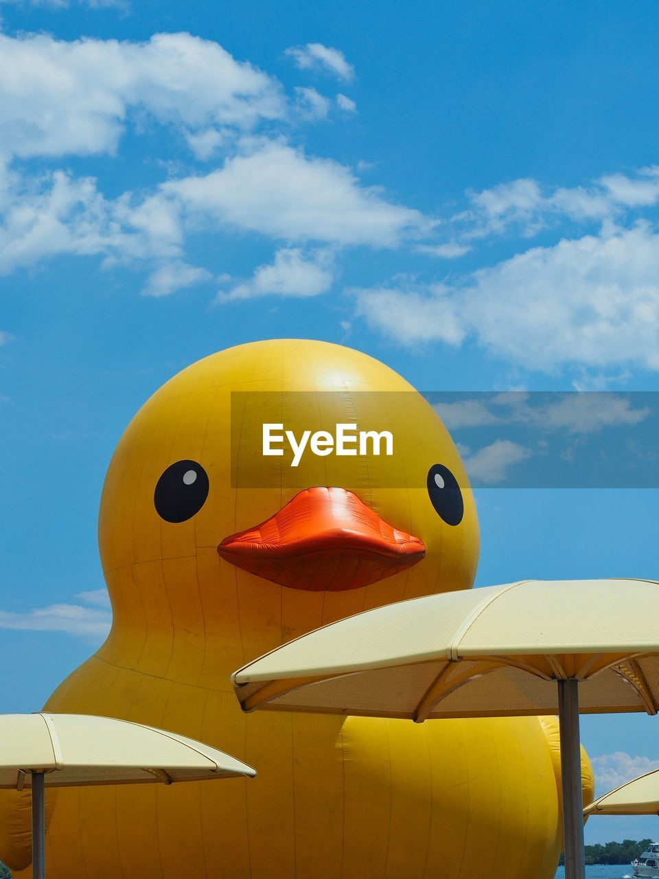 Inflatable duckling against sky