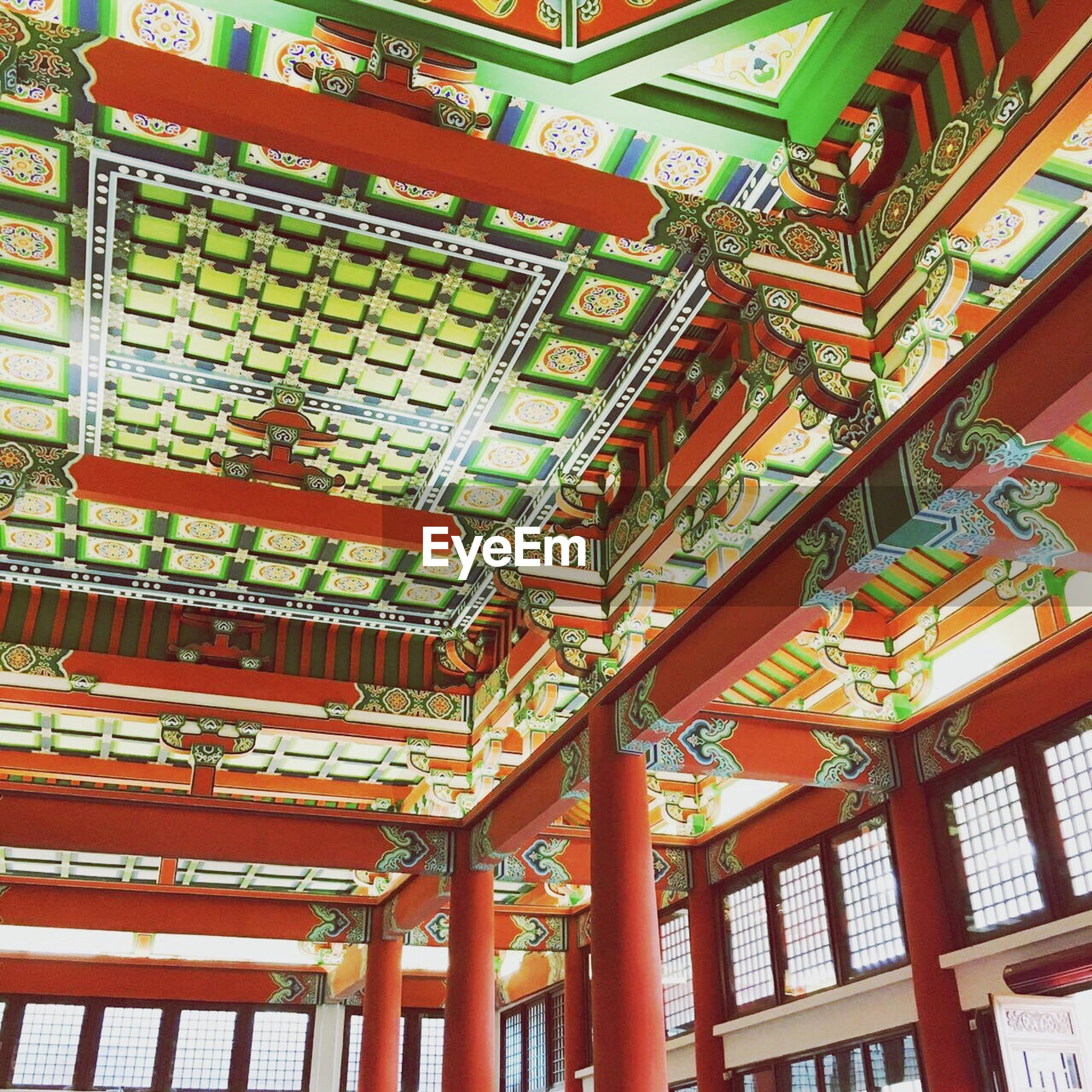 low angle view, ceiling, architecture, culture, architectural feature, ornate, place of worship, in a row, temple - building, multi colored, day, repetition, full frame, red, collection