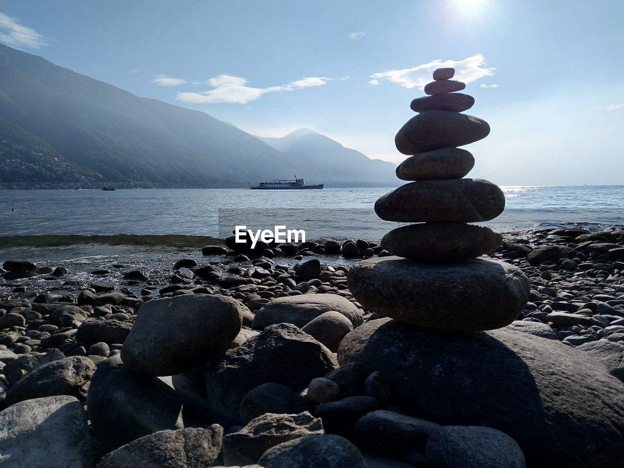 water, solid, rock, sky, stack, stone - object, sea, beach, scenics - nature, beauty in nature, rock - object, tranquility, pebble, balance, stone, nature, tranquil scene, land, zen-like, no people