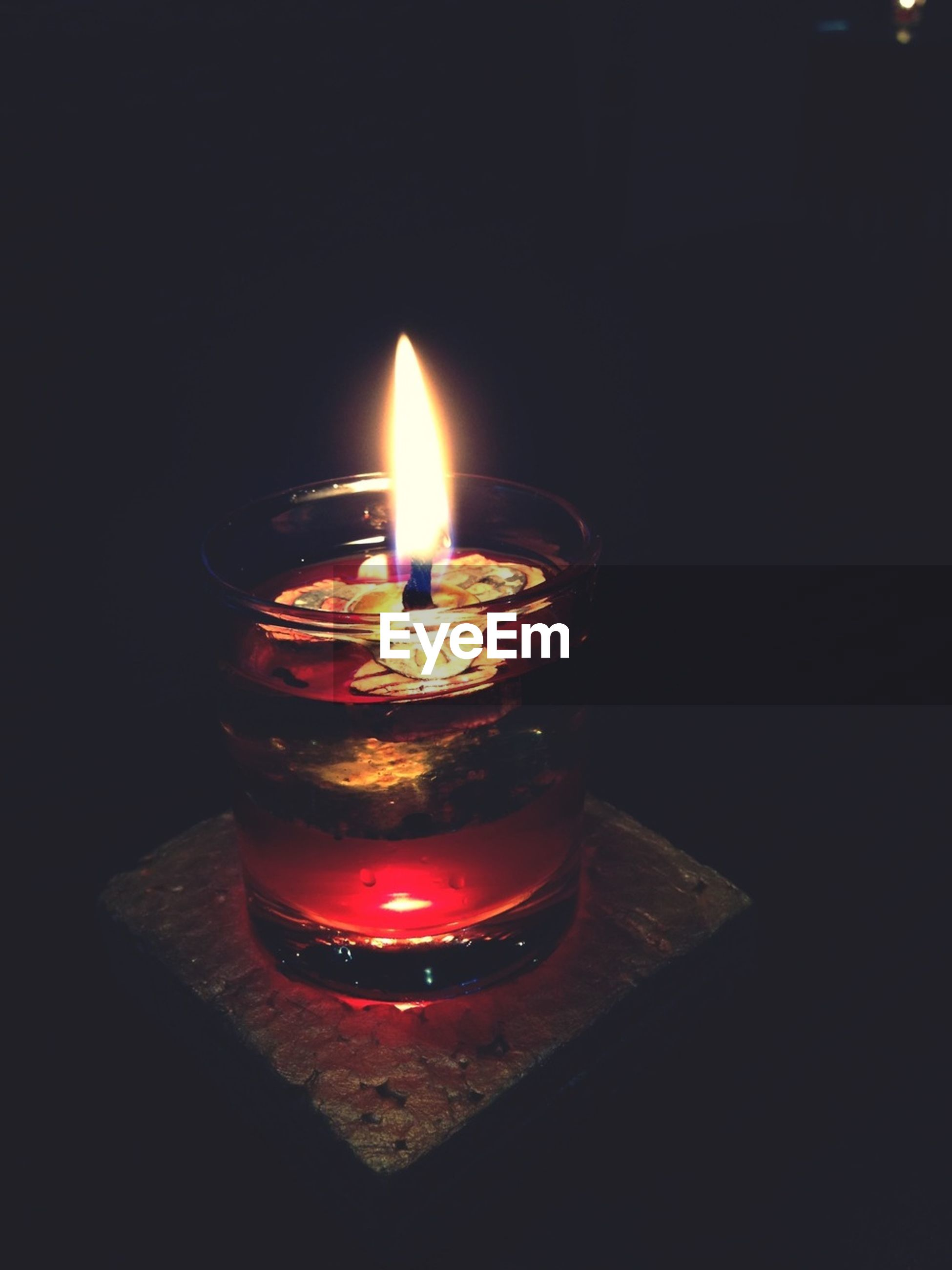 flame, burning, candle, fire - natural phenomenon, illuminated, glowing, heat - temperature, lit, indoors, candlelight, close-up, fire, dark, night, tea light, darkroom, studio shot, black background, still life, copy space