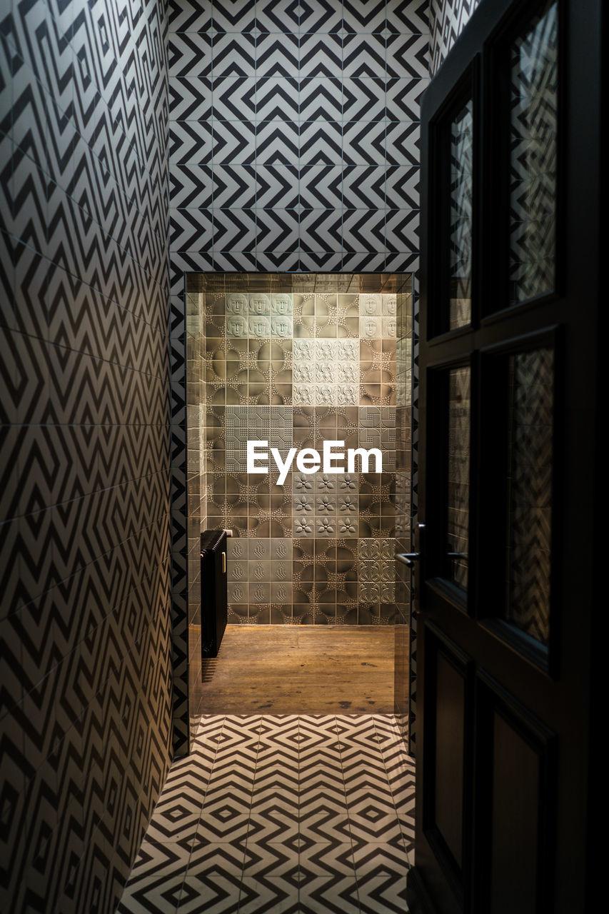 Illuminated room seen through doorway