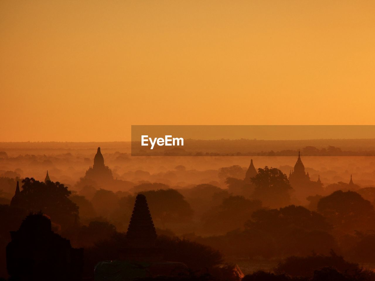 Silhouette of temples during sunset