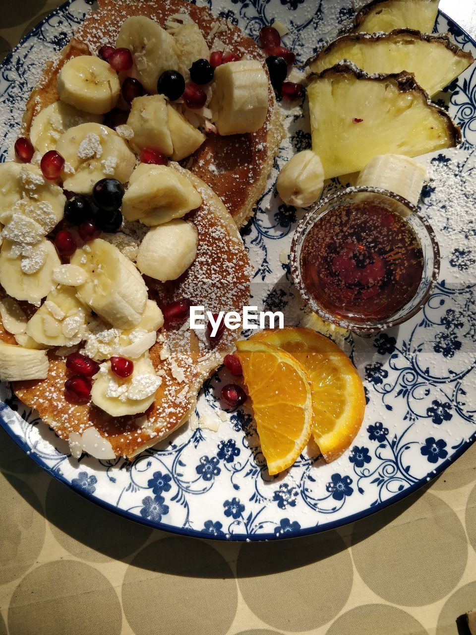 food, food and drink, fruit, freshness, indoors, still life, ready-to-eat, indulgence, high angle view, healthy eating, no people, sweet food, sweet, directly above, citrus fruit, dessert, close-up, plate, table, temptation, breakfast, snack