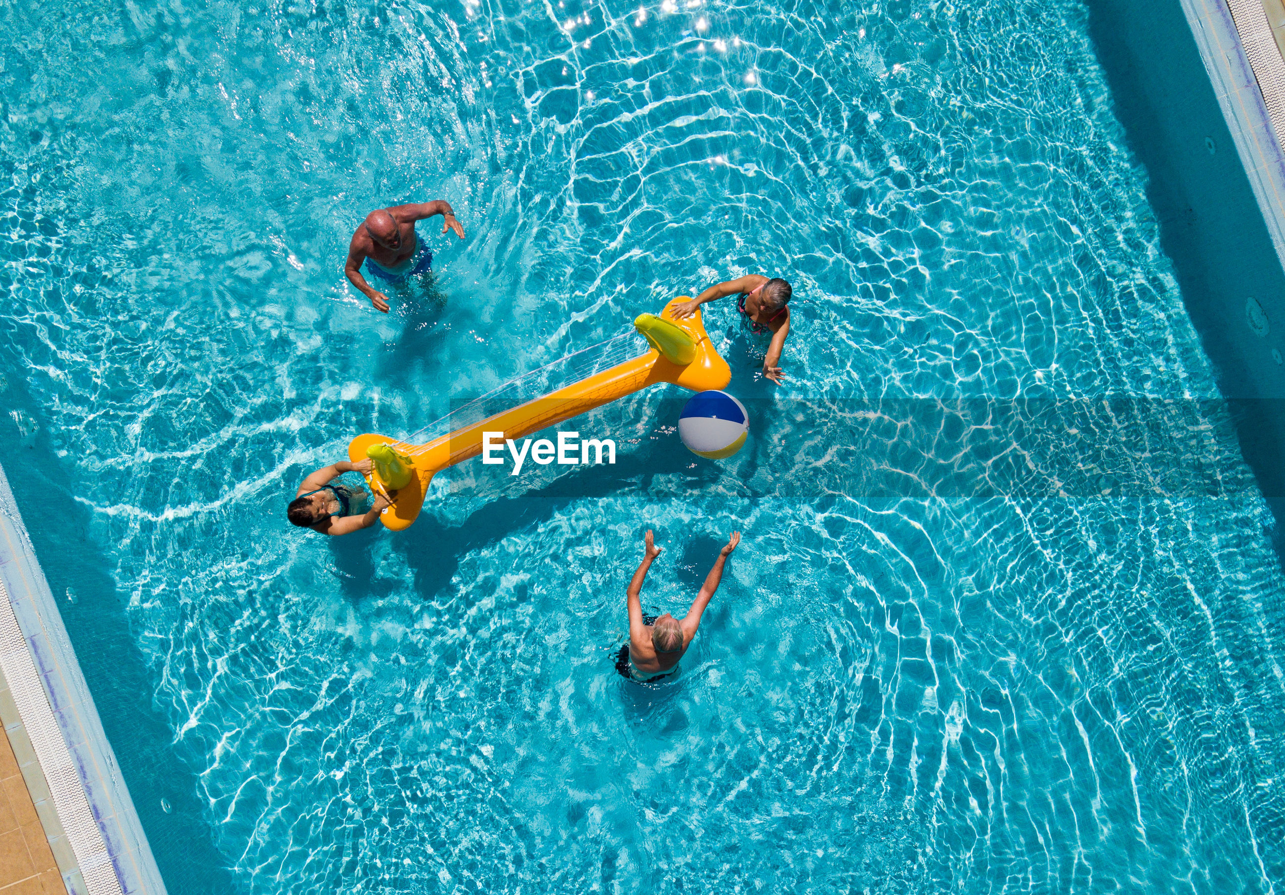 HIGH ANGLE VIEW OF SCUBA SWIMMING IN POOL