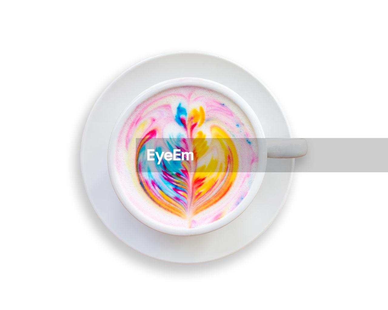 Multi colored cappuccino over white background
