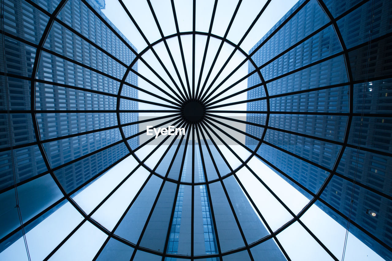 Directly Below Shot Of Buildings Seen Through Skylight