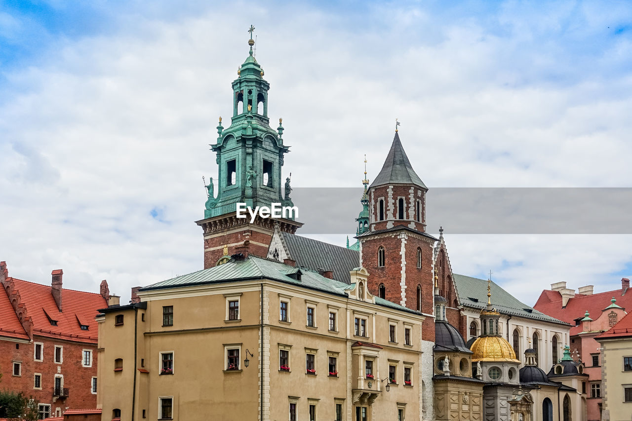 architecture, building exterior, built structure, building, sky, tower, cloud - sky, low angle view, place of worship, travel destinations, religion, nature, belief, spirituality, day, city, no people, the past, clock, outdoors, spire