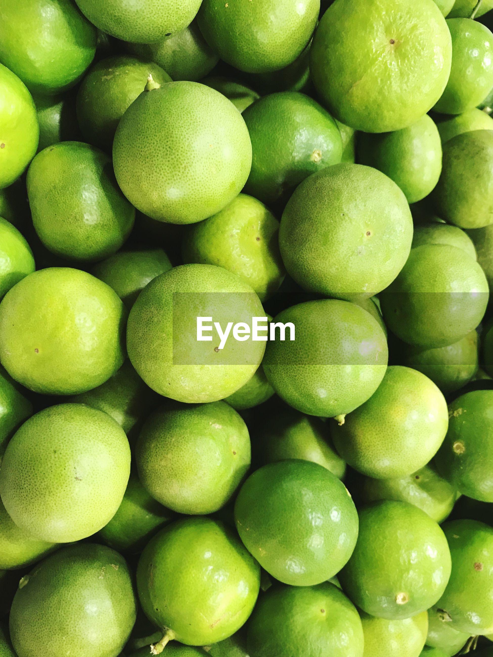 FULL FRAME SHOT OF GREEN LEMONS
