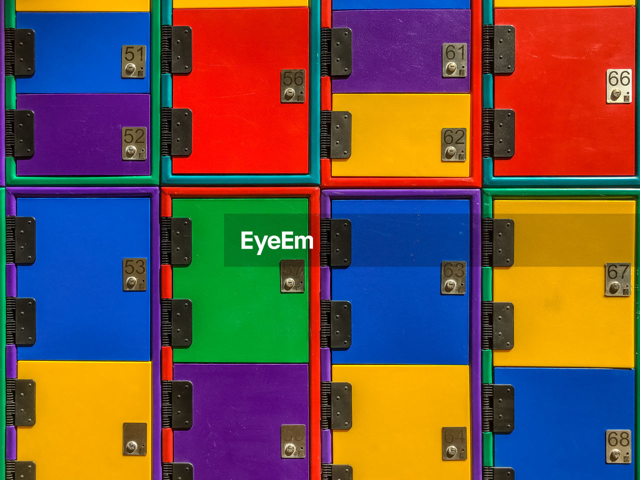 full frame, multi colored, backgrounds, indoors, no people, variation, large group of objects, choice, blue, yellow, side by side, repetition, pattern, in a row, abundance, close-up, arrangement, communication, stack, container
