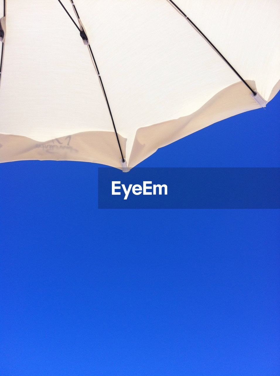 blue, umbrella, shade, clear sky, sky, beach umbrella, protection, copy space, parasol, security, low angle view, no people, sunshade, day, nature, outdoors, close-up, shelter, safety