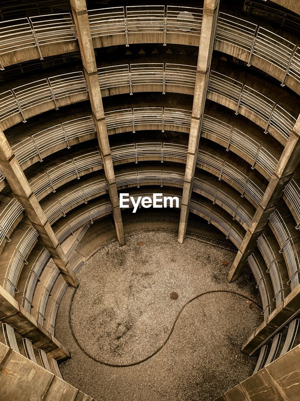 no people, pattern, architecture, indoors, wood - material, high angle view, built structure, day, stack, arch, old, geometric shape, in a row, brown, metal, industry, circle, abandoned, staircase, ceiling